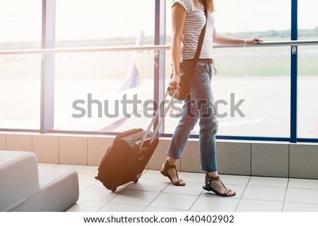 Young woman with her luggage at the airport