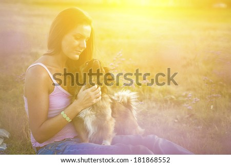 Young woman with her pekingese dog