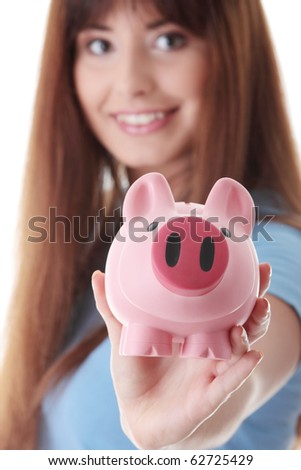 Young woman with her piggy bank, isolated on white background - stock photo