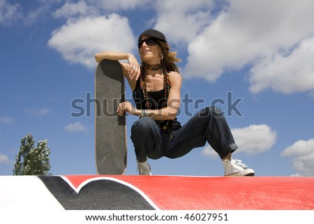 Young woman with her skate - stock photo