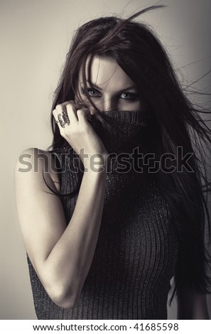 Young woman with high collar portrait. - stock photo
