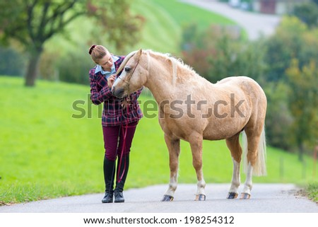 Young woman with horse - stock photo