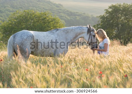 Young woman with horse outdoor - stock photo