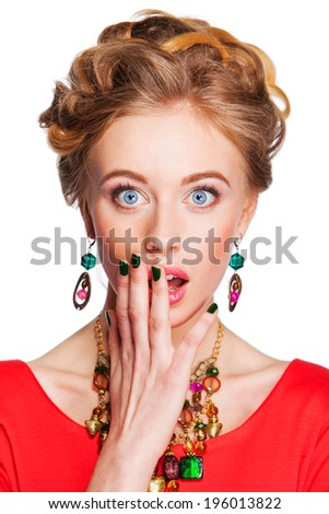 young  woman with jewelry surprised Isolated - stock photo