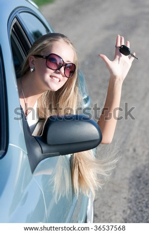 young woman with keys of the car - stock photo