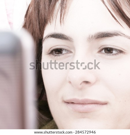 Young woman with laptop in bed . - stock photo