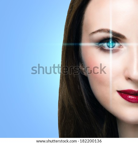 Young woman with lines scanning the eye. Medicine or biometrics concept with copy space. - stock photo