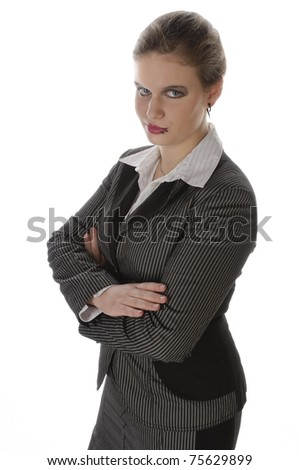 Young woman with lip piercing in a gray business suit and high heels, isolated on a white background - stock photo