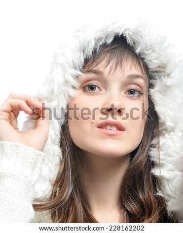 young woman with long brown hair  in fur white hat. isolated on white - stock photo