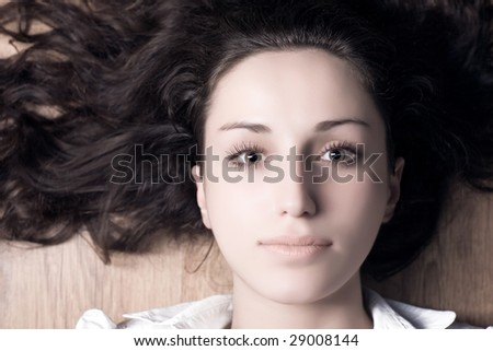 Young woman with long brunette hair portrait. - stock photo
