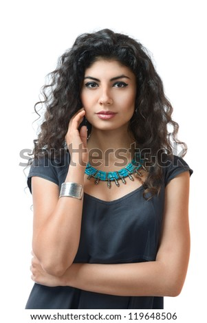 Young woman with long curly hair isolated on white background - stock photo