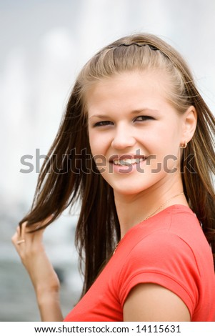 Young woman with long hair portrait. - stock photo