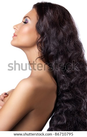 Young woman with long shiny hair isolated
