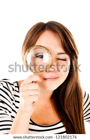 young woman with magnifying glass isolated on a white background - stock photo