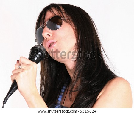 Young woman with microphone singing concept. Woman music performer - stock photo