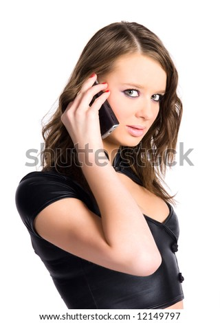 Young woman with mobile phone. Isolated on white. - stock photo
