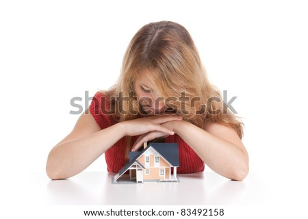 Young woman with model of house.