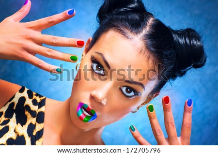 Young woman with multicoloured makeup. - stock photo