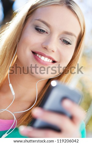 Young woman with music player
