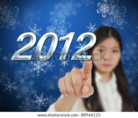 Young woman with 2012 new year background - stock photo