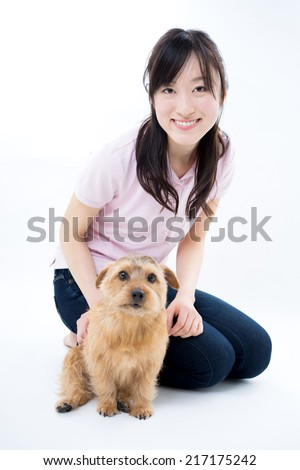 Young woman with Norfolk terrier dog, isolated on white background
