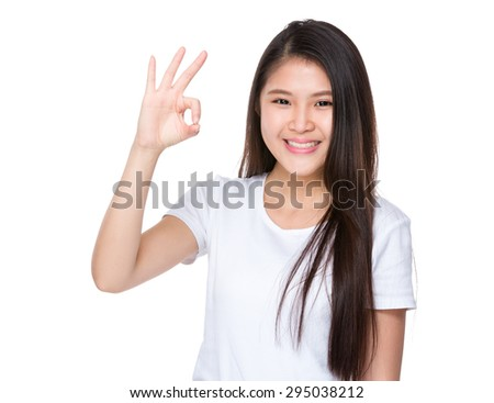 Young woman with ok sign gesture - stock photo