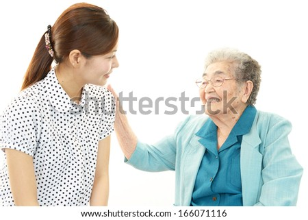 Young woman with old lady
