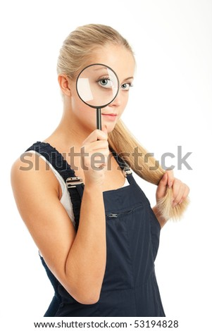 young woman with overalls on, white backgroung - stock photo
