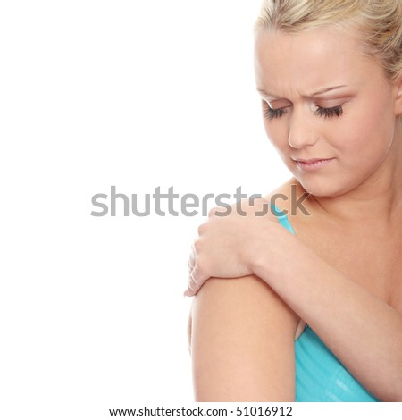 Young woman with pain in her arm. Isolated - stock photo