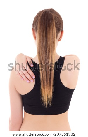 young woman with pain in her back isolated on white background - stock photo