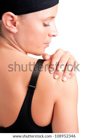 Young woman with pain in her shoulder - stock photo