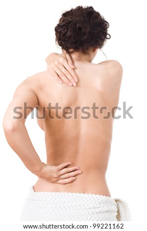 Young woman with pain in the back - stock photo