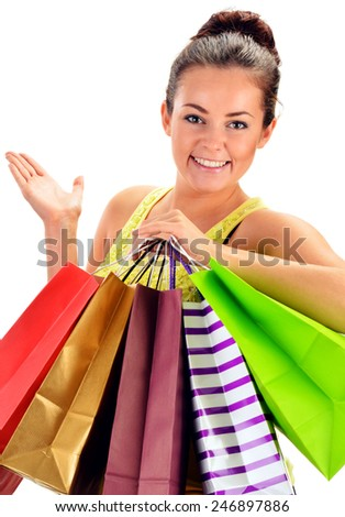 Young woman with paper shopping bags isolated on white background