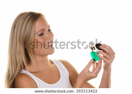 young woman with perfume bottle - stock photo