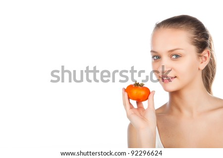 young woman with persimmon against white background - stock photo