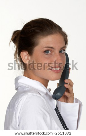 Young Woman with Phone Looking Over Shoulder - stock photo