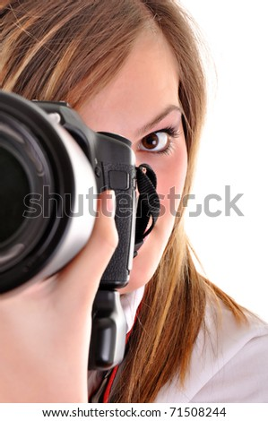 young woman with photographic camera on white background