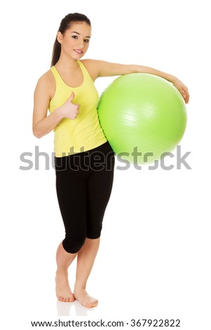 Young woman with pilates ball.
