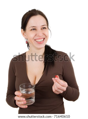 Young woman with pills in hand - stock photo