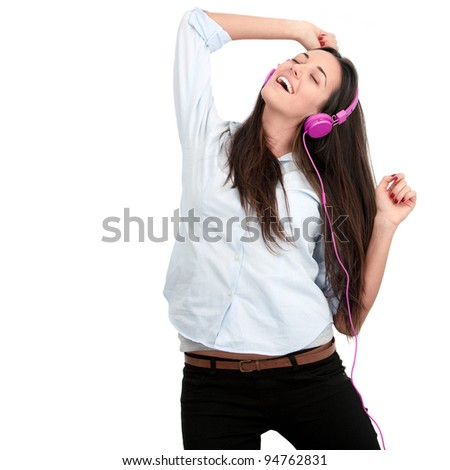 Young woman with pink headphones dancing.Isolated. - stock photo