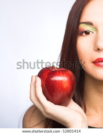 Young woman with red apples in her hands