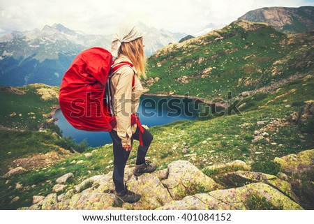 Young Woman with red backpack mountaineering Travel Lifestyle concept lake and mountains landscape on background vacations adventure journey outdoor  - stock photo