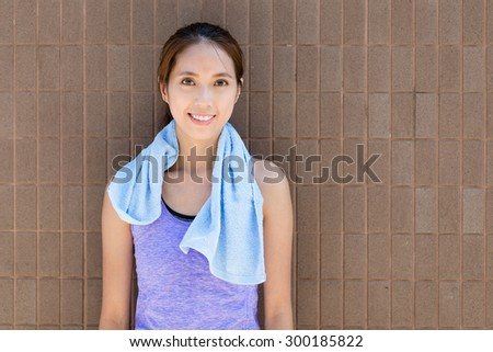 Young woman with red brick wall - stock photo