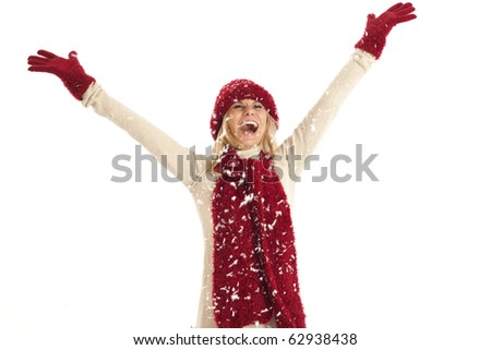 Young woman with red hat and scarf throwing snow - stock photo