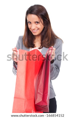 young woman with red shopping bag - stock photo