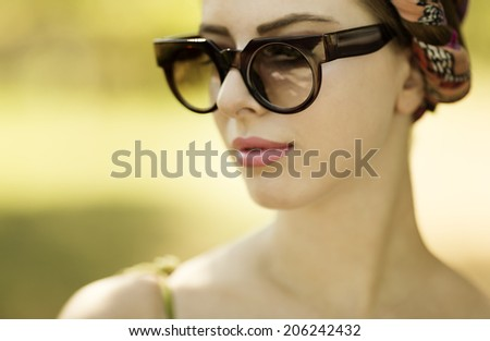 young woman with retro sunglasses ,natural light - stock photo