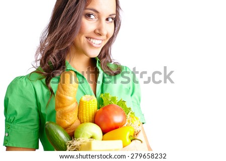 Young woman with sack of healthy products looking at camera - stock photo