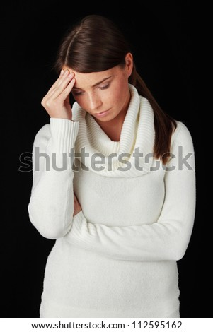Young woman with sad expression on face - stock photo