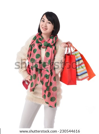 young woman with scarf holding shopping bags
