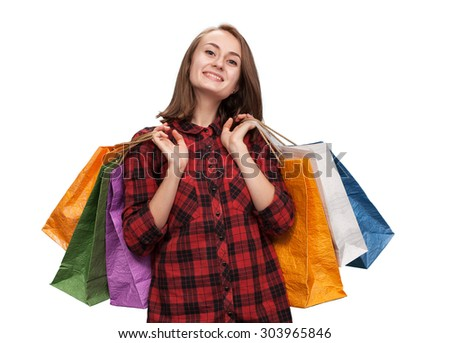Young woman with shoping bags isolated on white background with copy-space